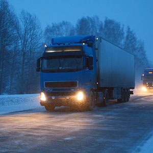 Truck driving through snow